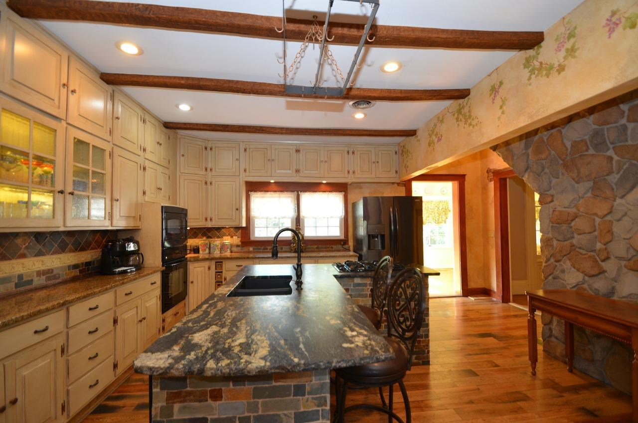 Another view of the kitchen with custom brick and stone work for that old world Italian feel.  And it's a super functional space!
