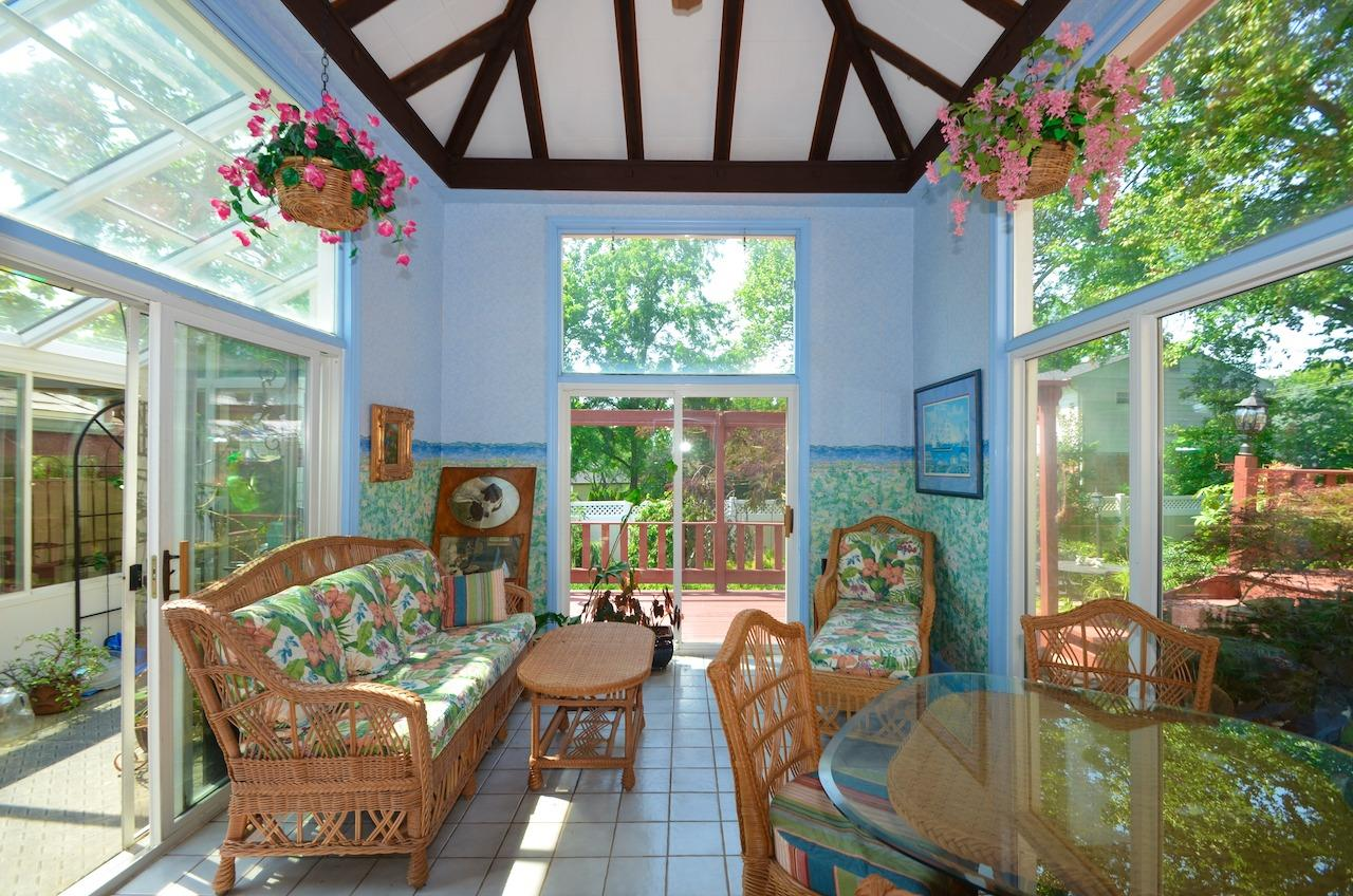 And the SOLARIUM is just gorgeous!  The pergola style roofline is echoed in the pool kitchen area.  This room has sliders on 2 sides to walkout to the greenhouse, decks & fountain/waterfall.