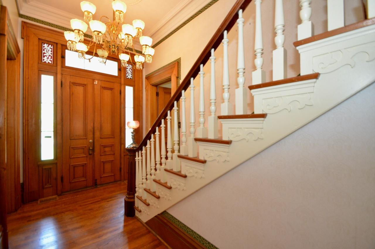 Once inside the lovely original architectural details are at every turn.  Cherry banister.  Butternut (white walnut) 8' doors.  12 ft ceilings.