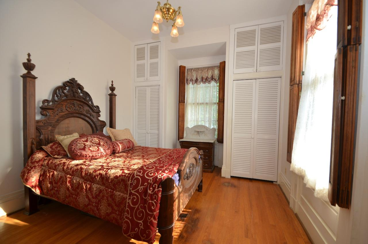 Bedroom 3.  One of 4 bedrooms on the second floor.  Just love the vintage interior shutters throughout the home.