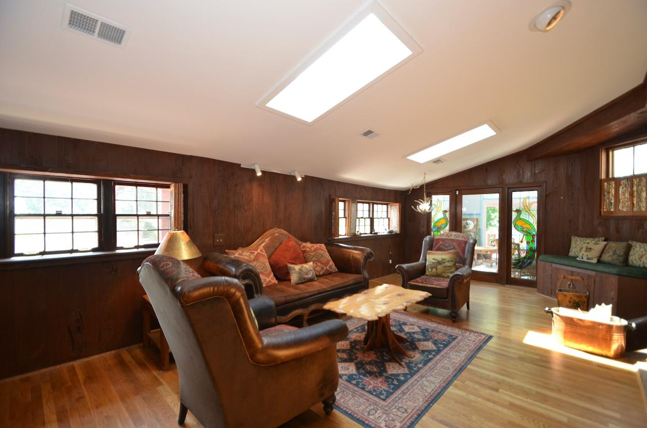Another view of the family room with walkout to the SOLARIUM!  There is also a built in window seat to the right.