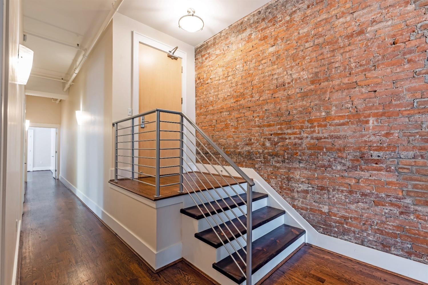 All new hardwood flooring throughout with exposed brick wall and large walk-in entry closet.