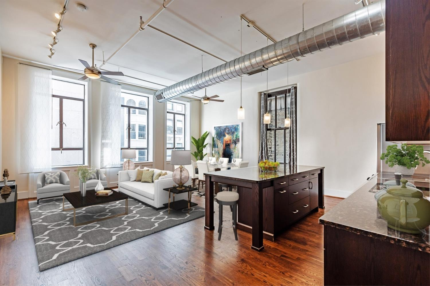 Spacious entertaining options from this light filled condo with huge windows looking out to Vine Street.  The parking garage is directly across the street with the elevator coming right to the valet station. Windows in this historic building where retro fitted with double pain insulated glass.