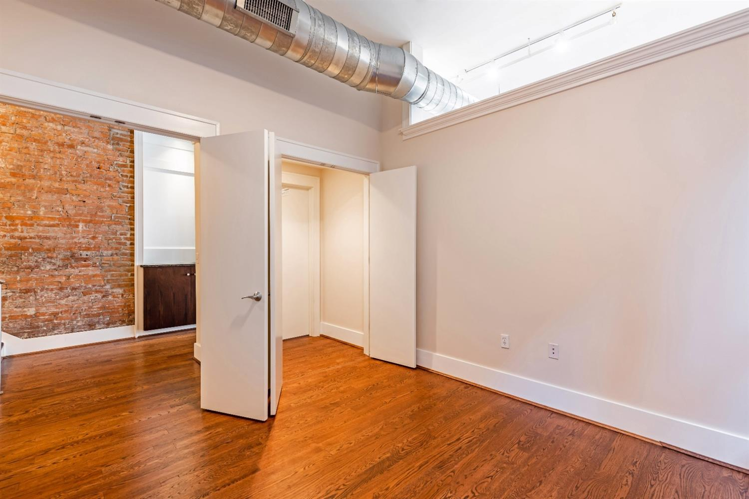 View from Bedroom 3/office, spacious walk-in closet opens from other side for coat closet. This is the un-staged photo.