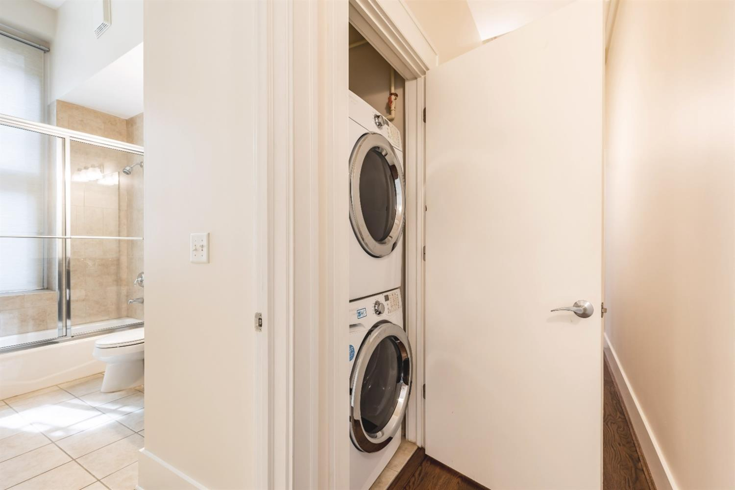 Laundry located outside bathroom 2, washer/dryer stays.