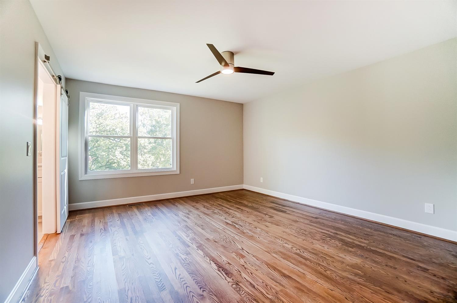 1st floor, Owner's bedroom, alternate view with windows - superb view of the park-like backyard offering seasonal views that can't be beat!