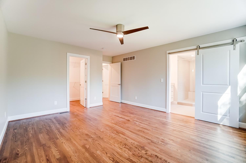 2nd floor, east-facing Owner's bedroom with generous walk-in closet, ceiling fan with remote. Gleaming hardwood floors. Barn door entry to bathroom.