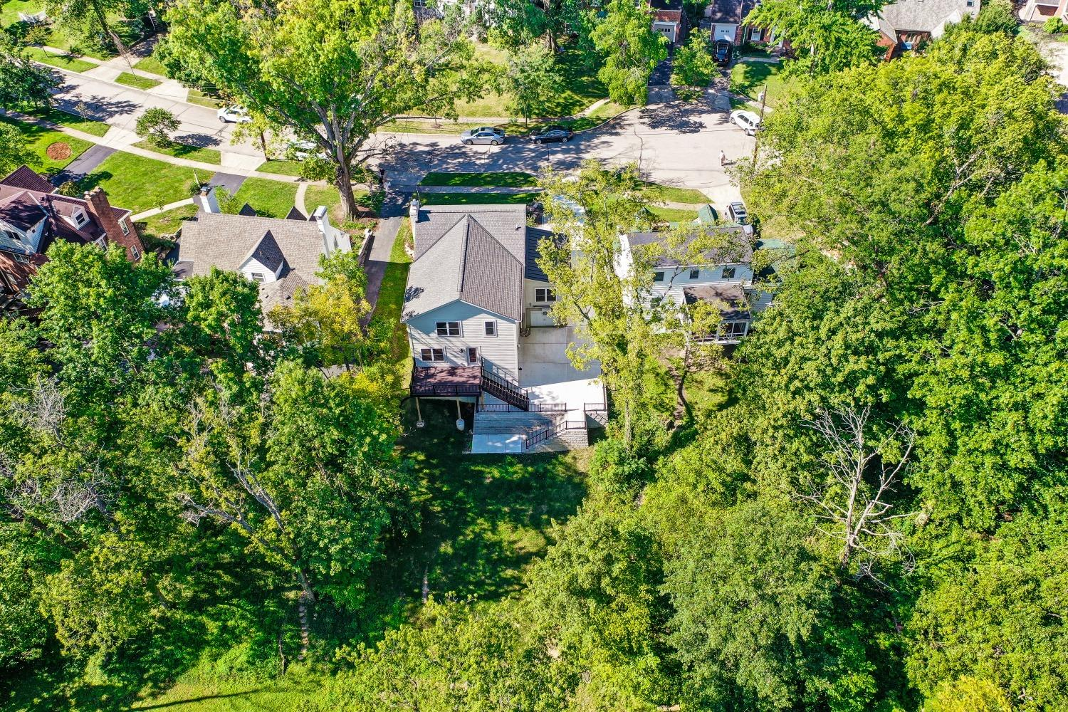 Aerial view of the home and lot. The wooded views from this home are gorgeous and include a small creek.