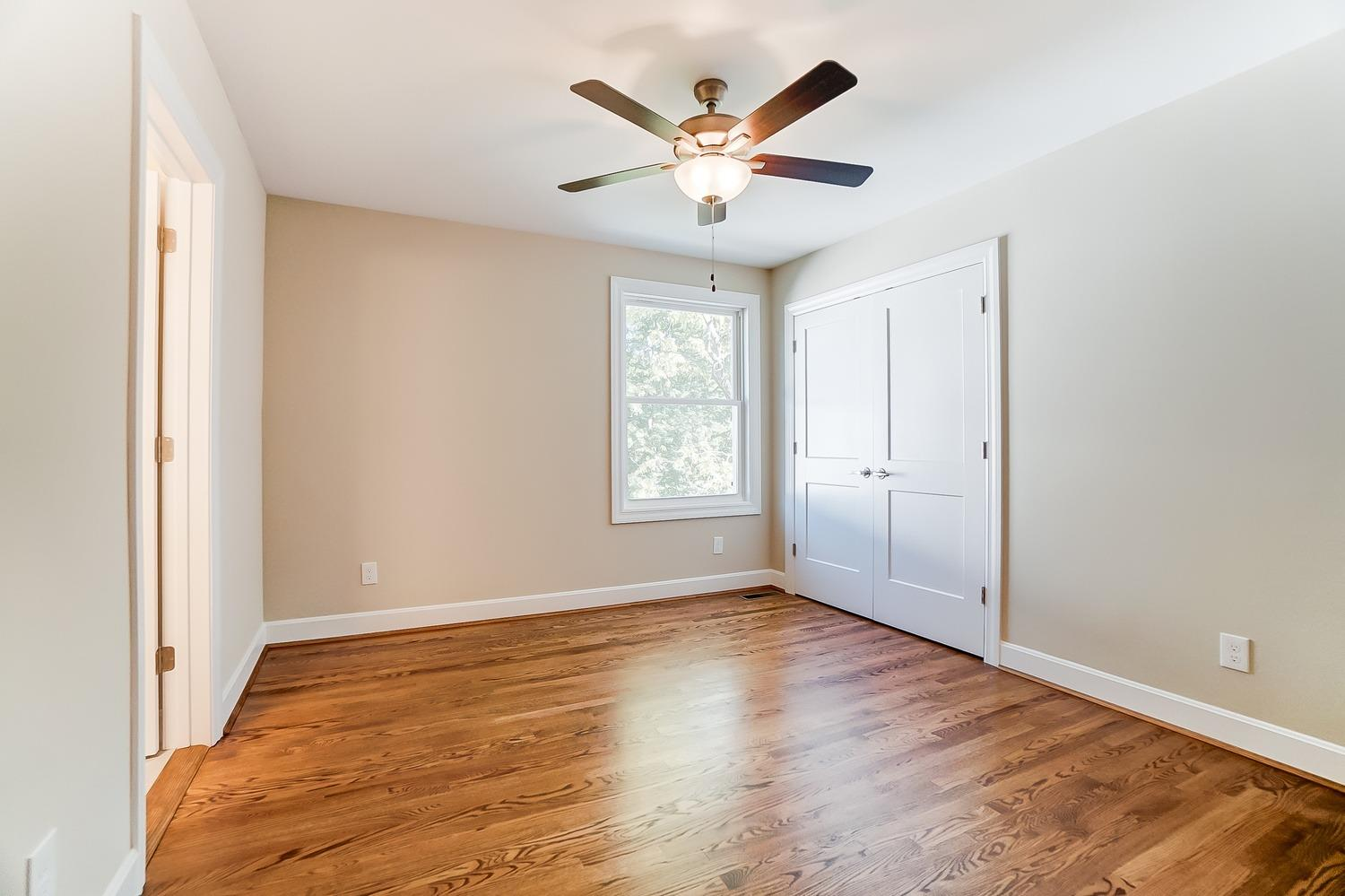 2nd floor, front bedroom (guest/nanny/grandparent/college student/airbnb room) offers generous space, extra large closet, full bath, gleaming hardwood floors.