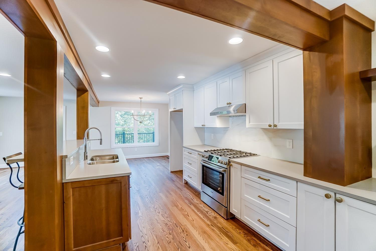 1st floor, kitchen with Bosch stainless appliances, mixed metals, wood cabinets with 5 piece drawers and soft closes. LED lighting. Microwave cubby and built-in garbage sorting drawer.