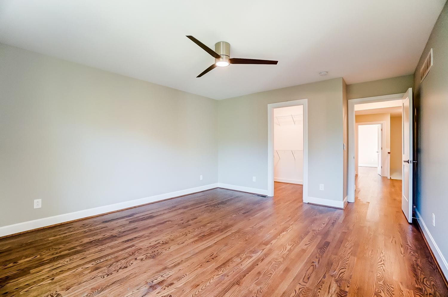 2nd floor, Owner's bedroom with generous walk-in closet, ceiling fan with remote. Gleaming hardwood floors.