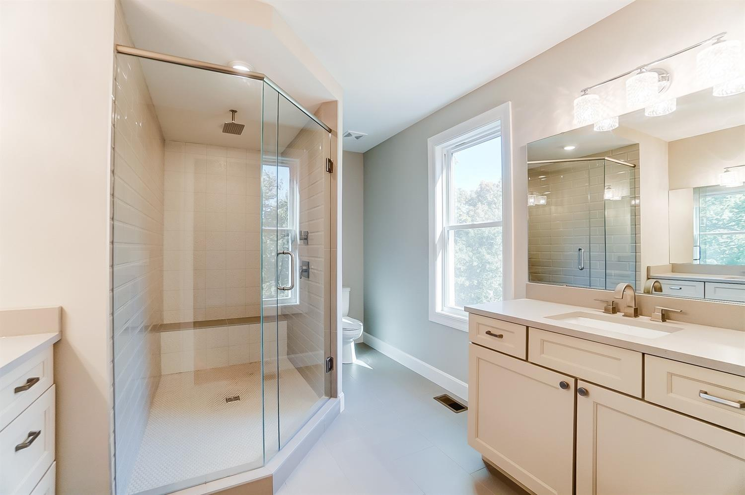 2nd floor, owner's bath is light and airy! Gleaming surfaces, warm cream, white and dove gray color scheme.