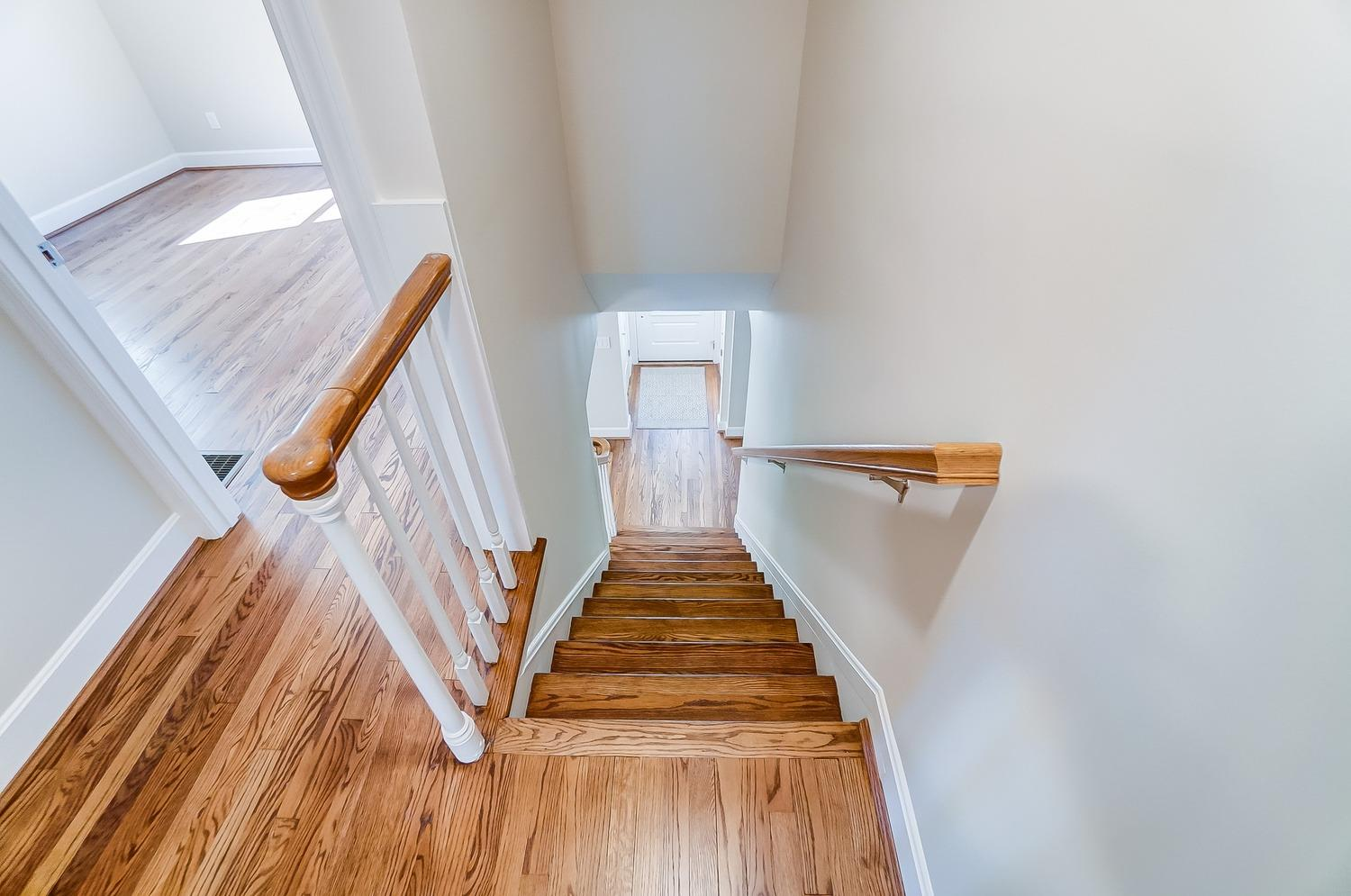 Alternate photo of 2nd floor landing and stairwell. Light and airy! Gleaming hardwood flooring all around!