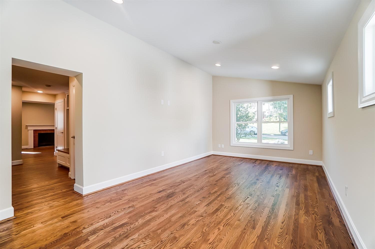 1st floor, alternate view of Bonus Room with tech wiring on wall. Open doorway to 1/2 bath, mudroom etc visible at left. Want more privacy, we think you could add a frosted multi-panel door here.