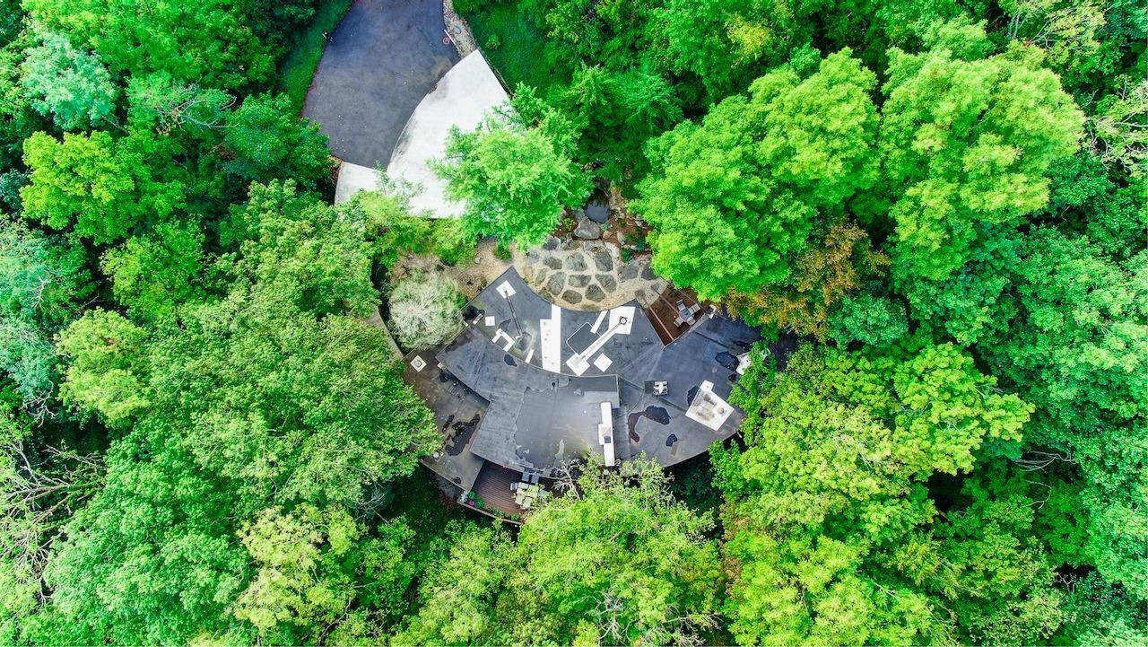 Aerial View.  It really is a semi circle!  Or in Wright speak, a Solar Hemicycle Usonian. Please click the 'virtual media' link to watch a video of this listing.