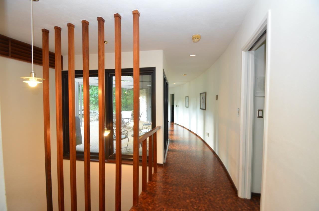 Here is that same hallway, from the other direction.  And the second staircase to the lower level, this one with vertical lines.