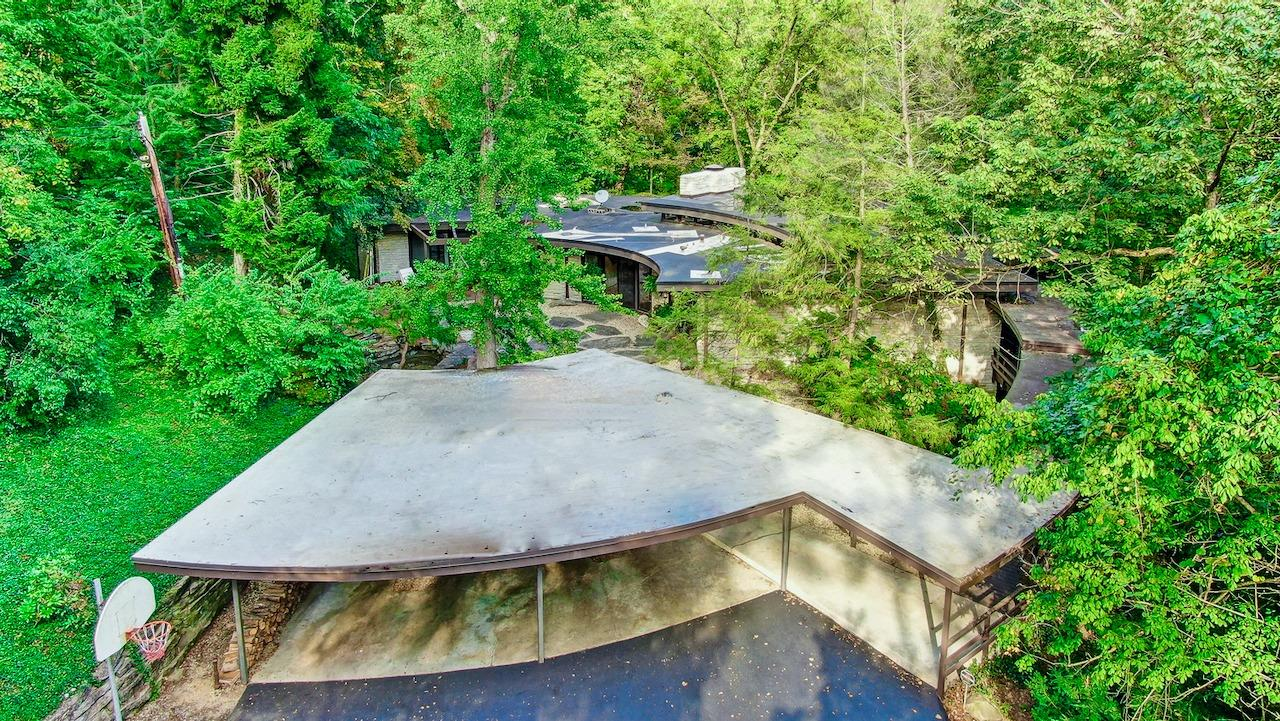 As mentioned earlier, see video for the more information.  The house is located at the end of a cul-de-sac, and 700 ft. down a private driveway.  The house is not visible at all from the street, yet is located in a sought after Cincinnati neighborhood, Wyoming, OH. Wyoming has secured a grant and is proposing to connect this neighborhood to the central business district (coffee shop, library, schools, civic center) via sidewalks. How wonderful!