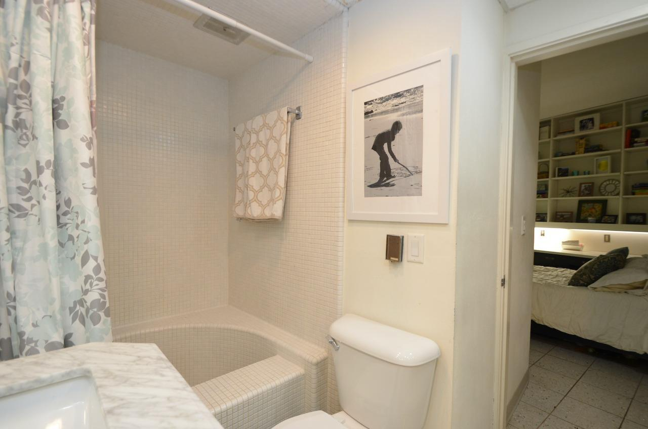 Adjoining bath between the LL bedrooms.  And Look at this cool D shaped mosaic tub/shower.
