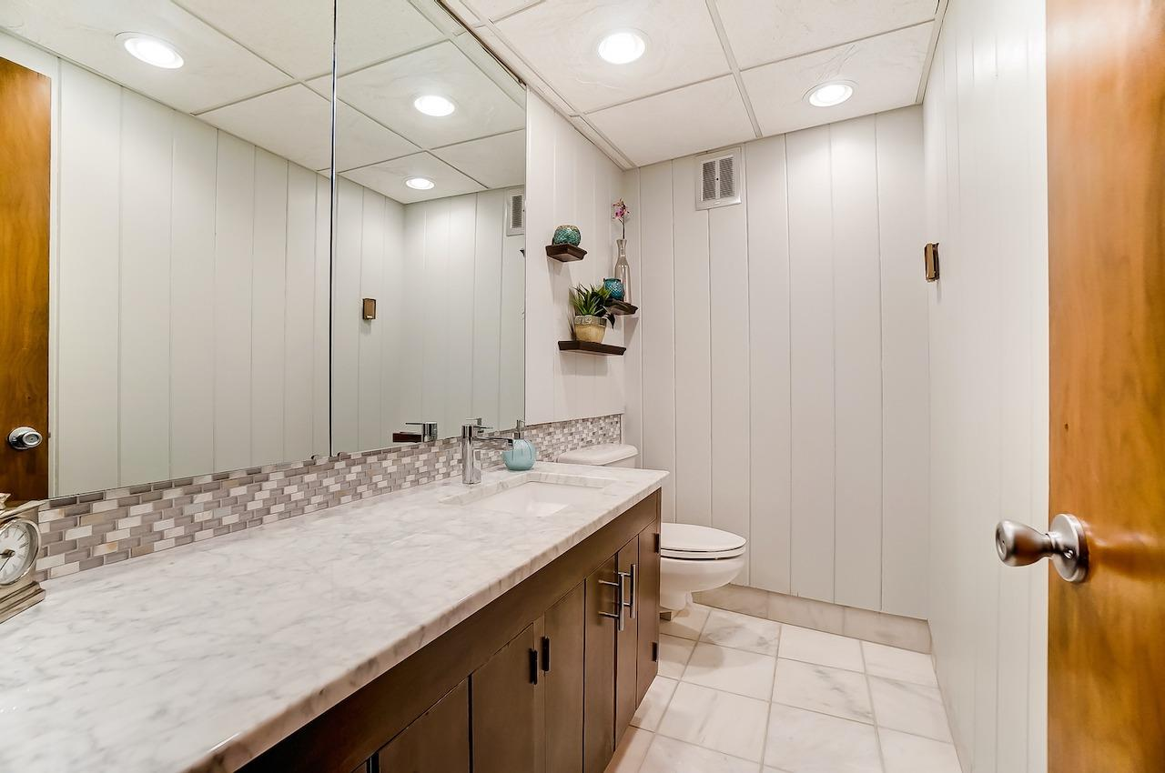 Main floor guest powder room - original but with some sensitive updates.