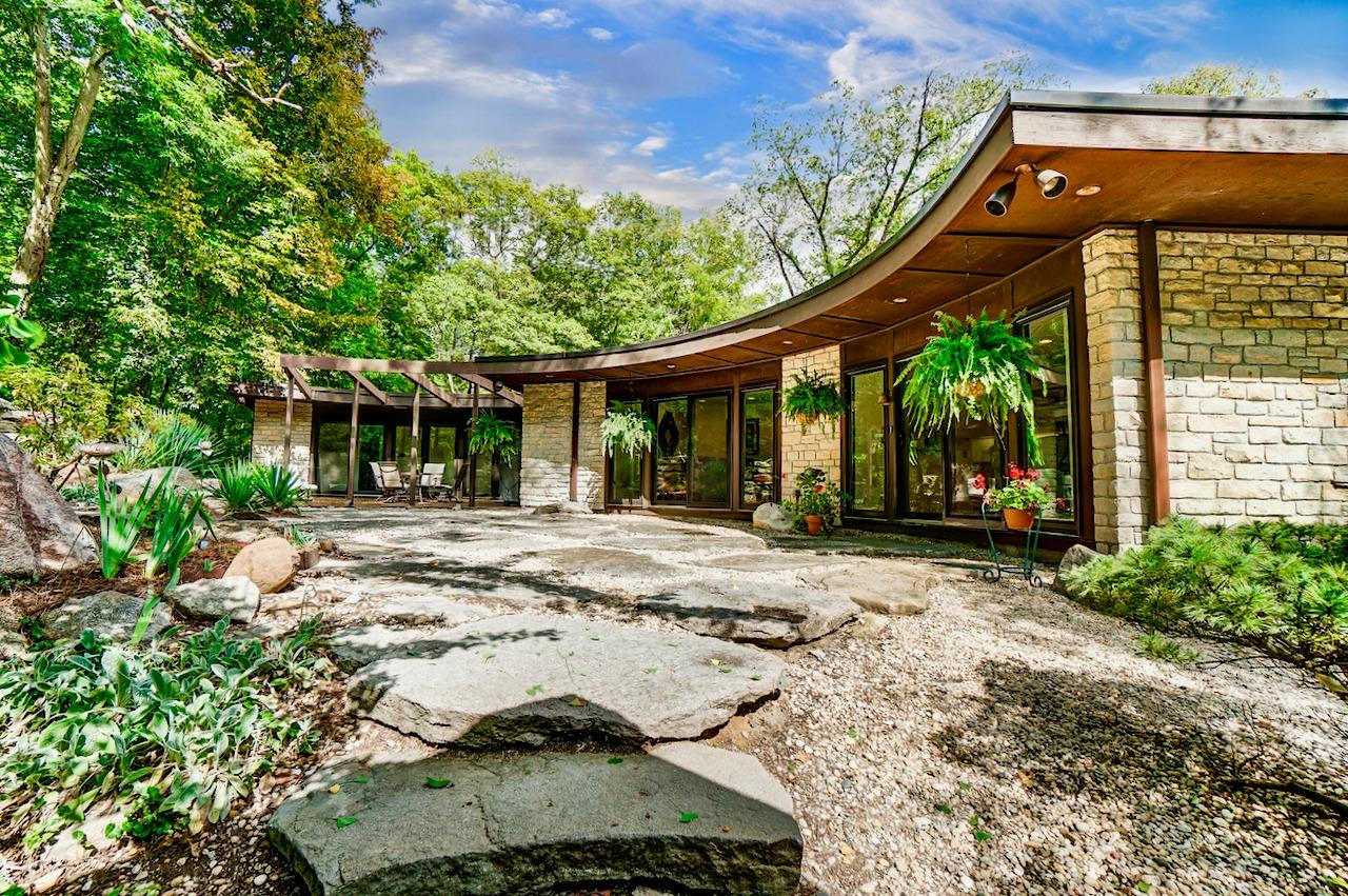 Not only is the home visually and functionally stunning, it is located in Wyoming, OH, a small city within a city (Cincinnati) with one of Ohio's top rated school districts, and also rated one of Ohio's top places to live.  This view shows walkouts from the kitchen, upstairs family room, and upstairs hall.