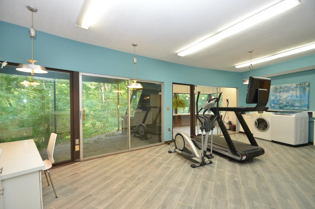 And perhaps the pièce de résistance!  The laundry/craft/exercise room to beat all laundry/craft/exercise rooms!  I mean, come on!  Is this real life?! This room is so amazing it has been used to film commercials.