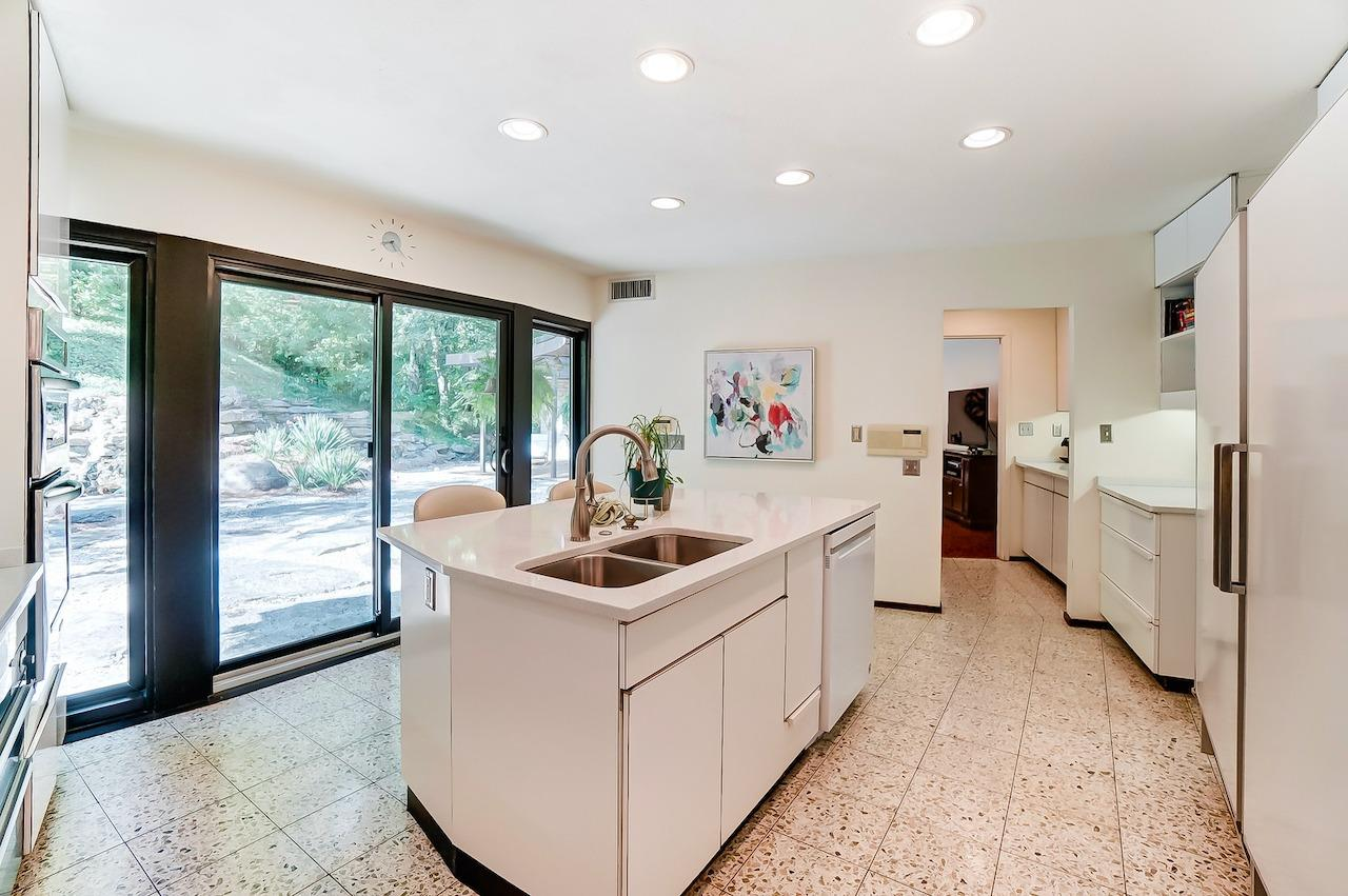 the sliding patio doors along this side of the house are all new.  This gorgeous terrazzo floor is original.