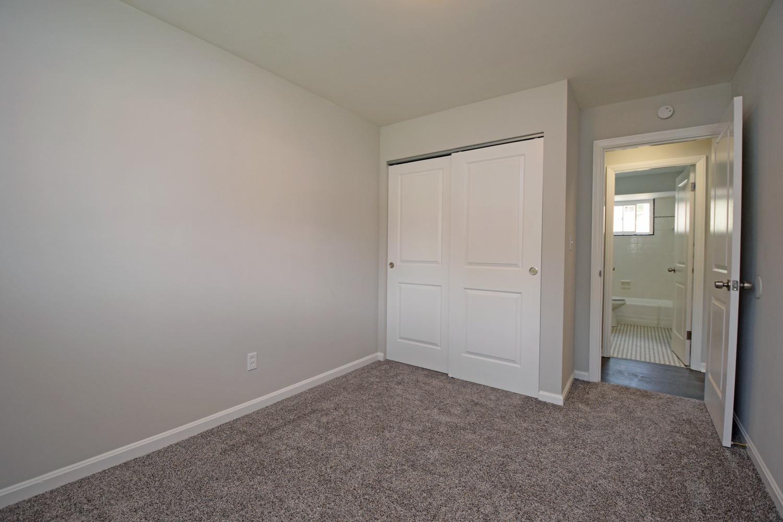 Bedroom 2, looking towards hallway