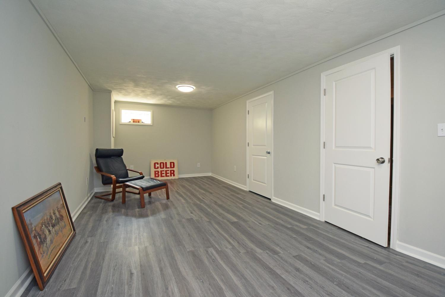 Rec Room with Closet and Doorway to Common Area