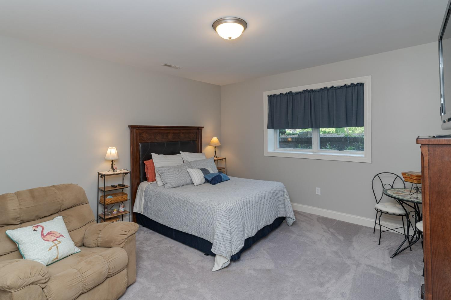 Lower level bedroom (with adjoining full bathroom).