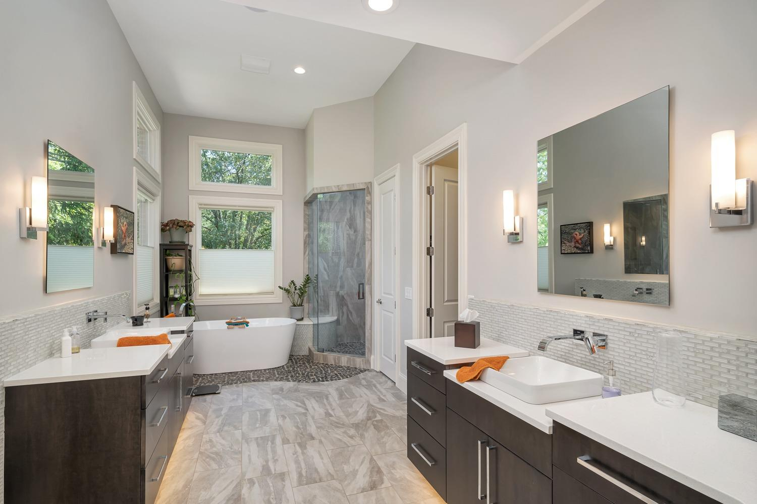Master bathroom is large and features heated floors, Graff faucets, and mirrors with LED backlighting.