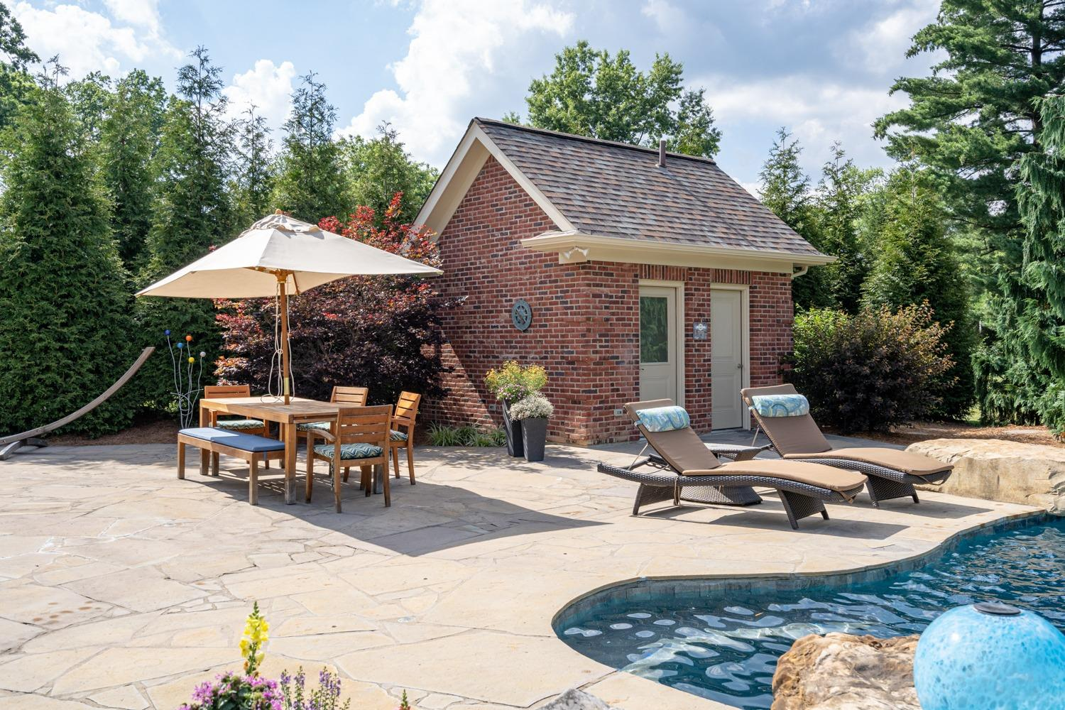 Pool house with 3 piece bathroom and pump/storage room. The pool filtration system is commercial grade and easy to operate and maintain due, in part, to a UV filtration system and 2 chlorinator towers.