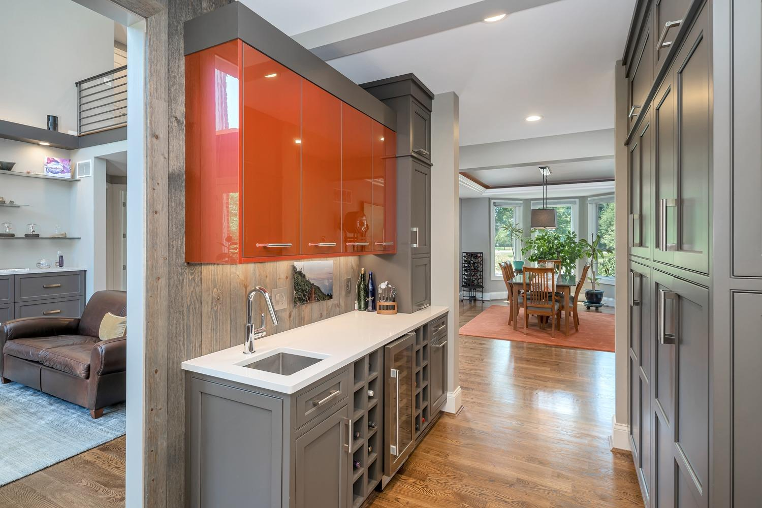 Butler's pantry features a wet bar w/wine refrigerator and abundant storage.