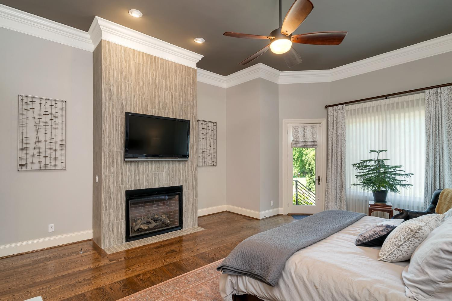Master suite with ceramic tile wrapped fireplace (gas) and walk-out to private jacuzzi spa.