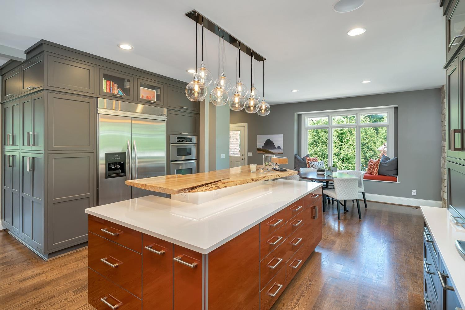 Kitchen features Plain and Fancy custom cabinets, a perfect blend of rustic and modern. For those keeping score upper cabinets are wired copper gloss acrylic and pantry and lower cabinets are maple in java enamel. Also shown is oversized Cambria countertop.