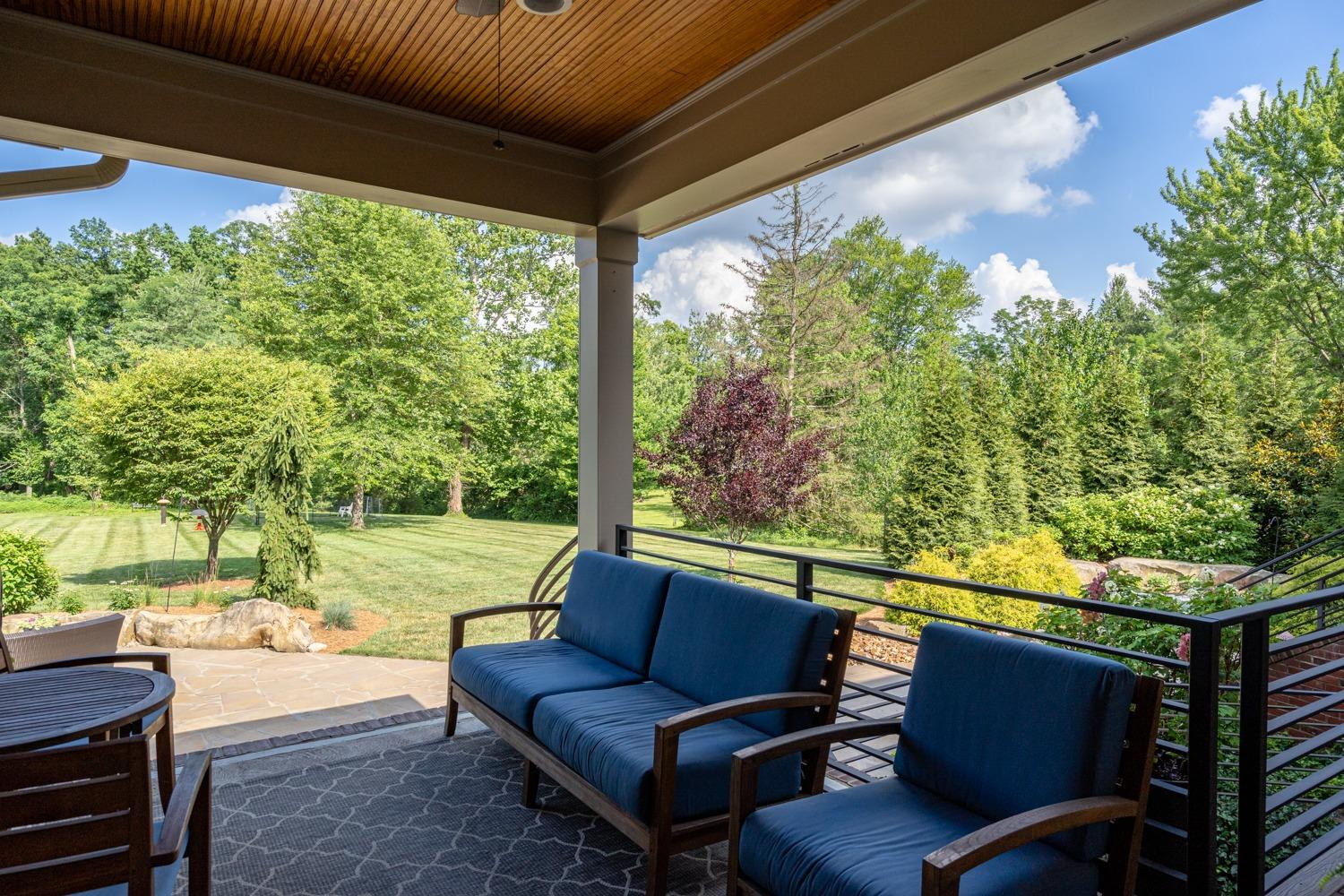 Relax in the shade on your patio with beadboard ceiling and fan.