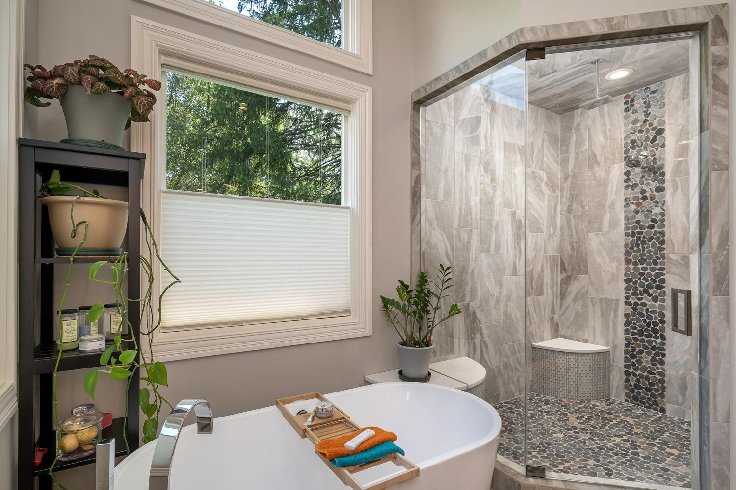 Master bathroom also features a steam shower with 2 shower heads (One is rain shower type) and a soaking tub with air massage.