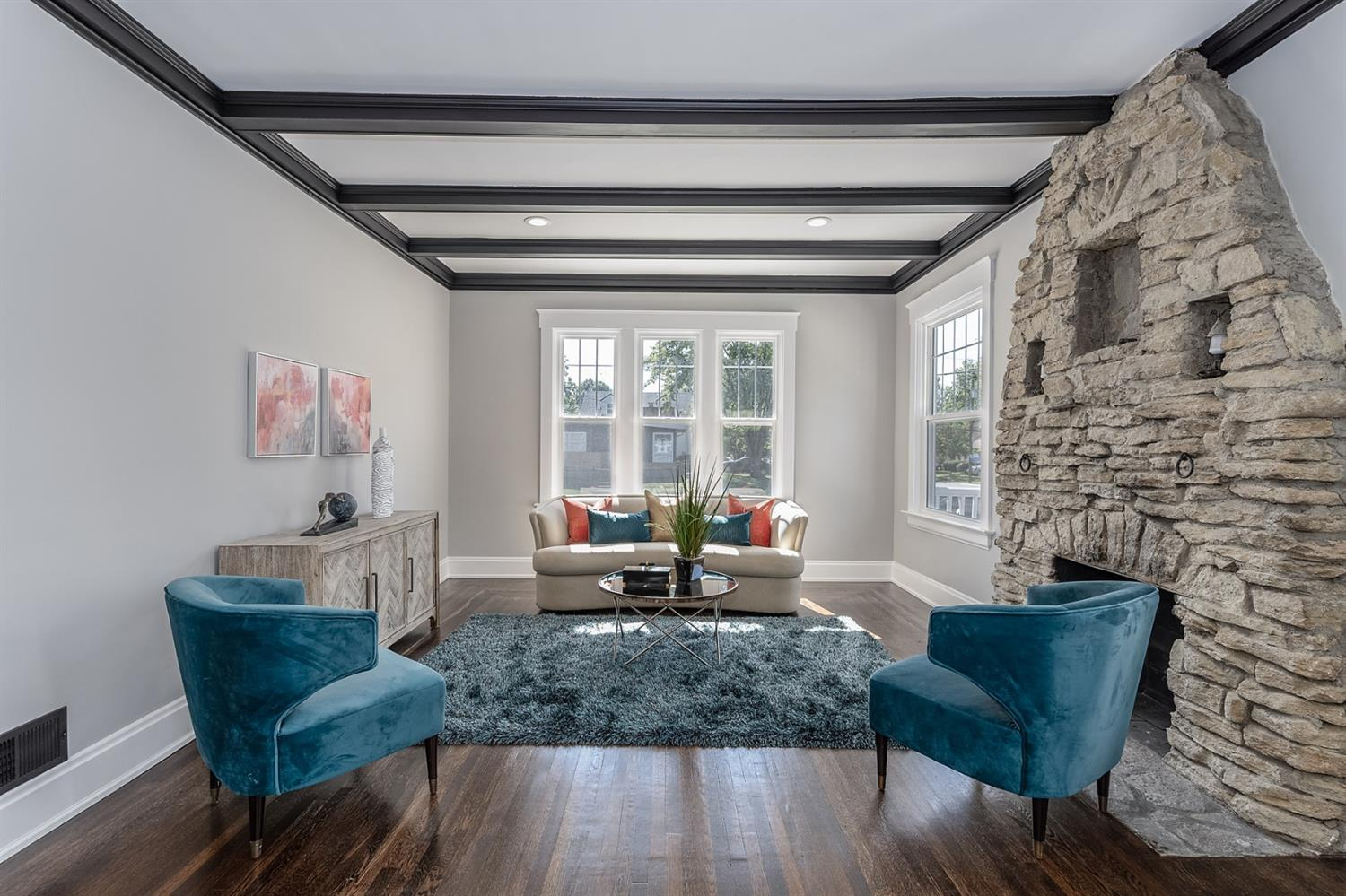 Living room with coffered beams.