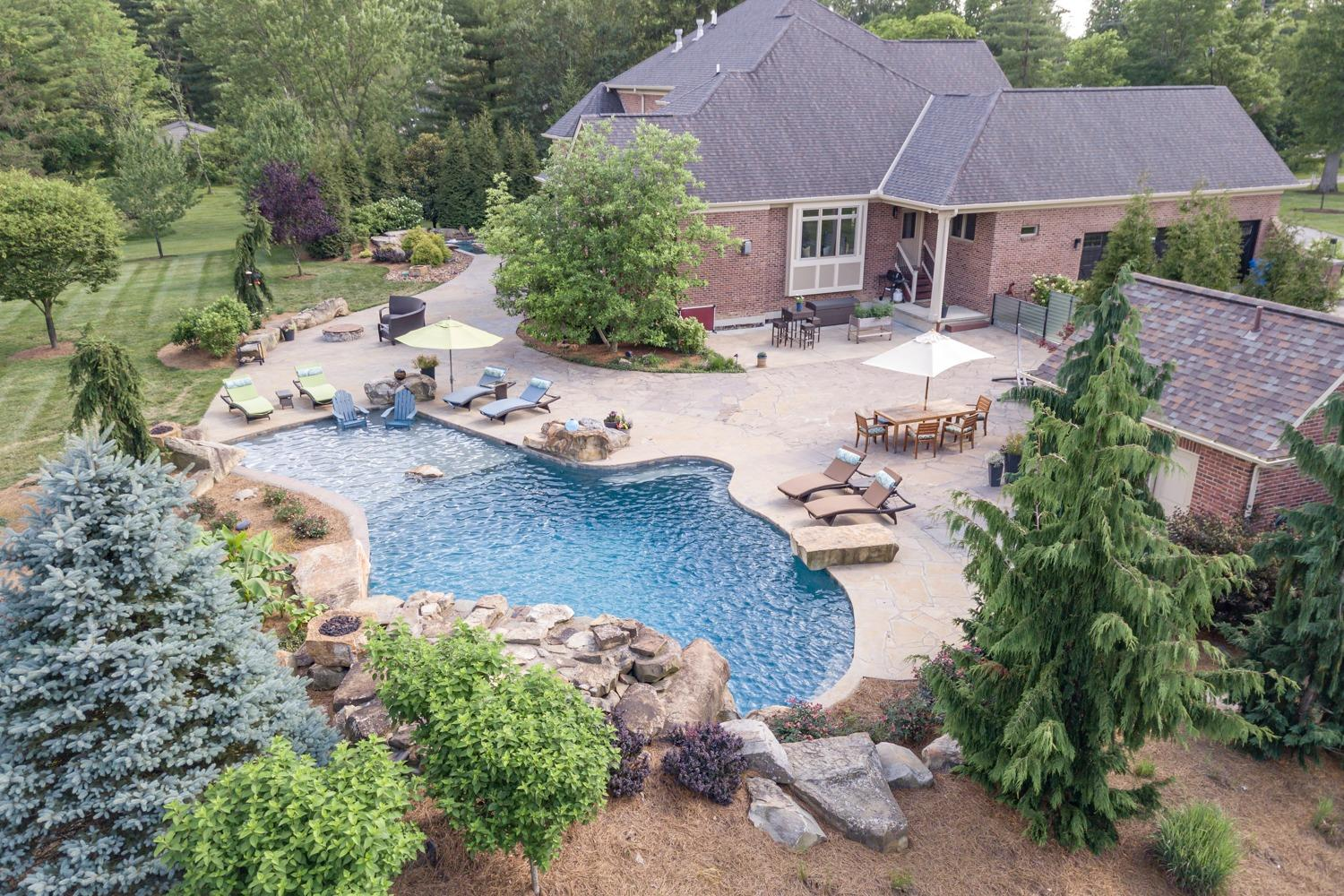 Blue spruce, berberis, and weeping cedars provide year round interest to the pool landscaping.