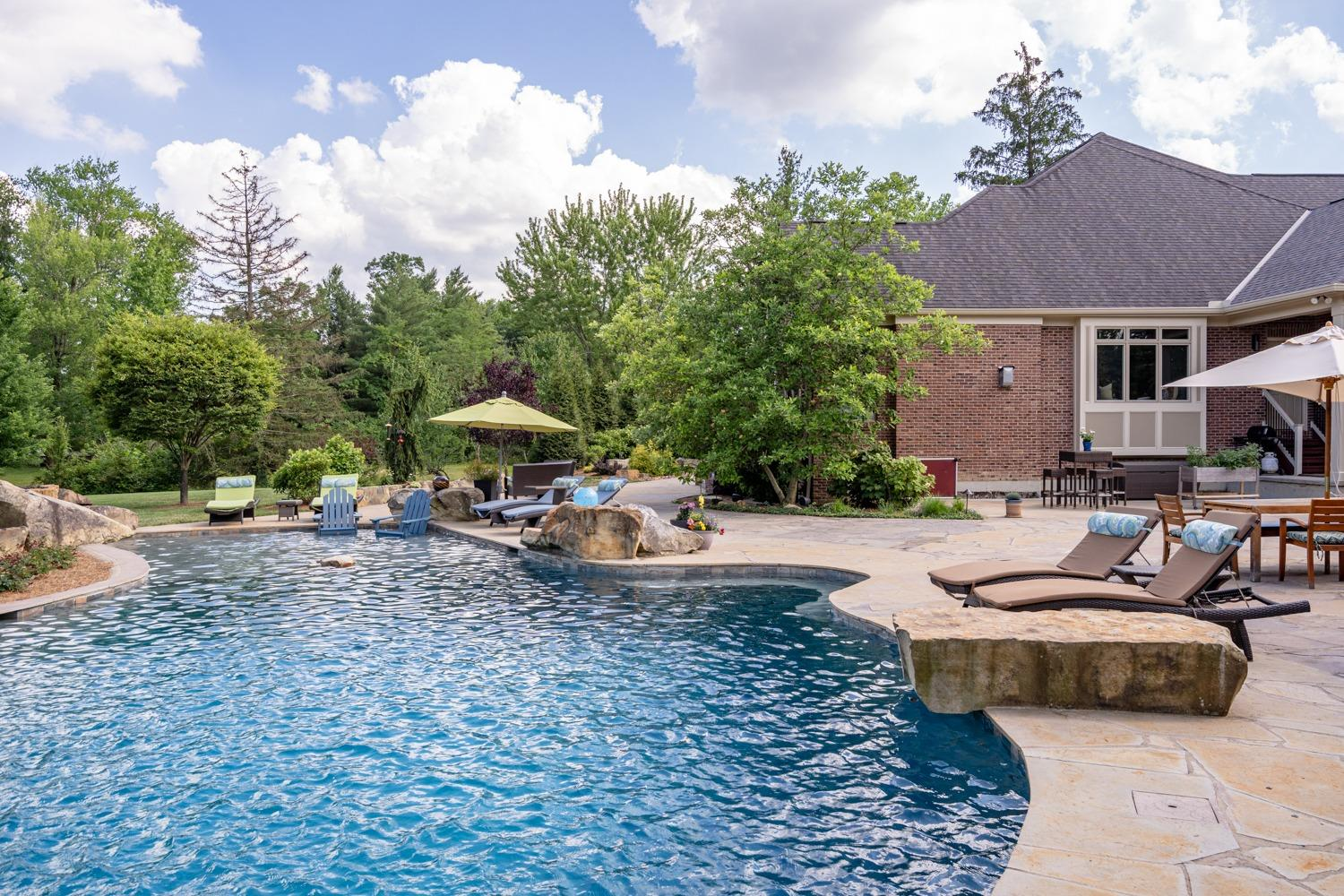 Relax with your feet in the water on the custom rock ledges.