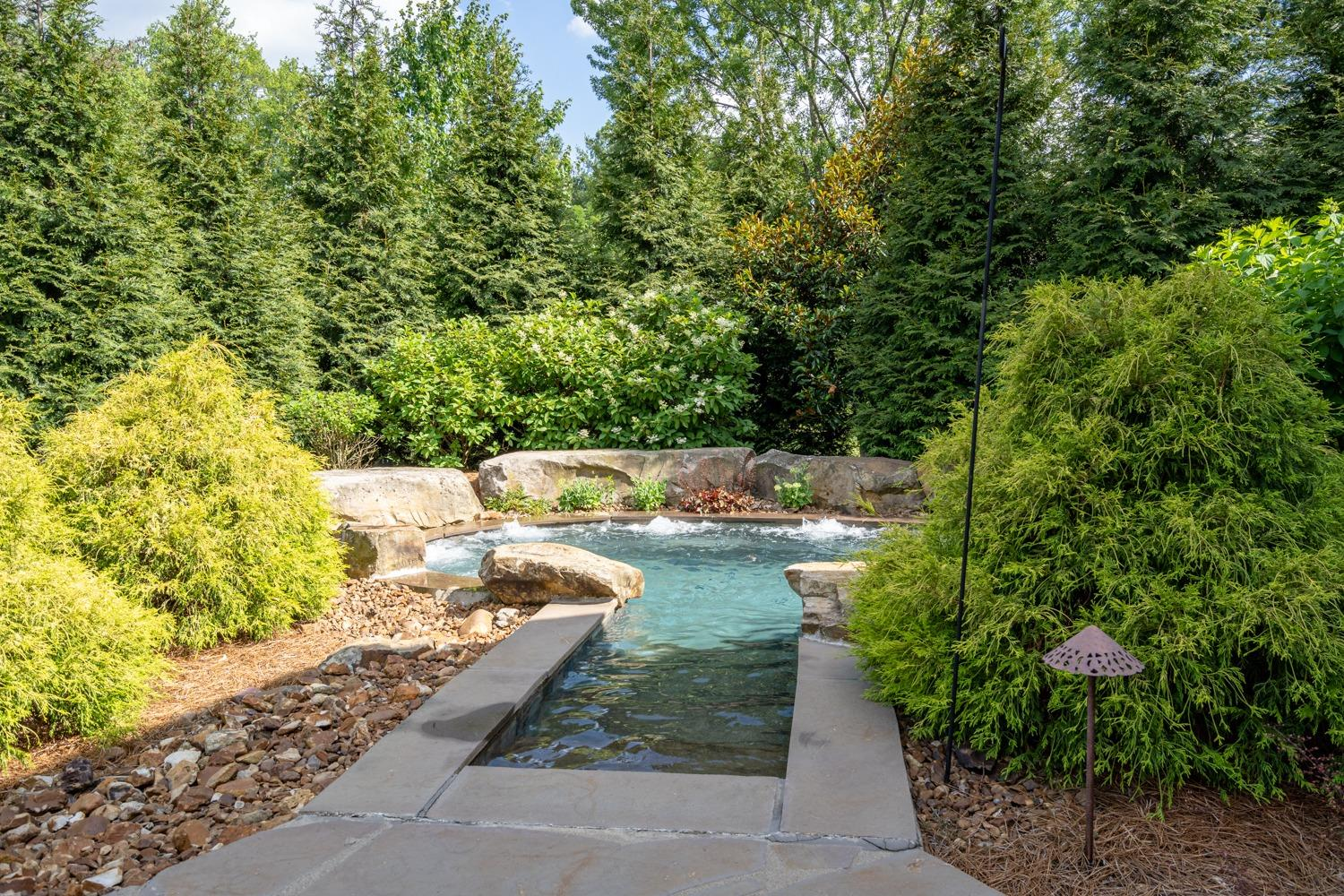 Access to spa from master suite. Spa is surrounded by beautiful landscaping.