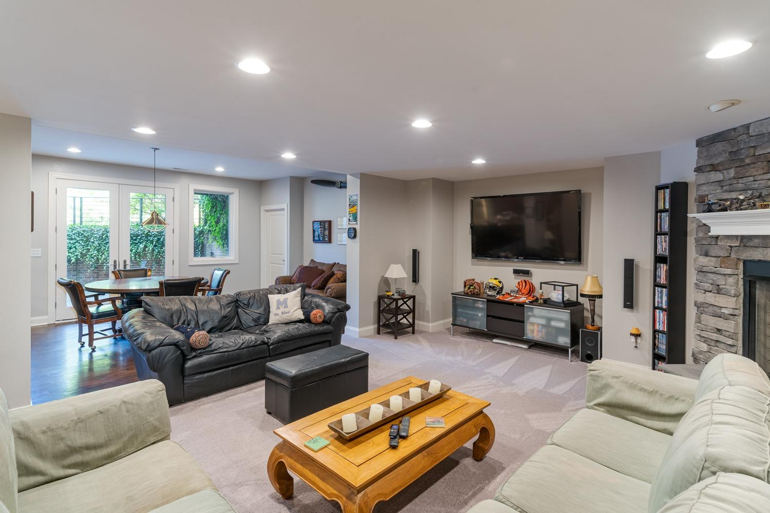 Lower level family room/recreation room… notice the walk-out in background.