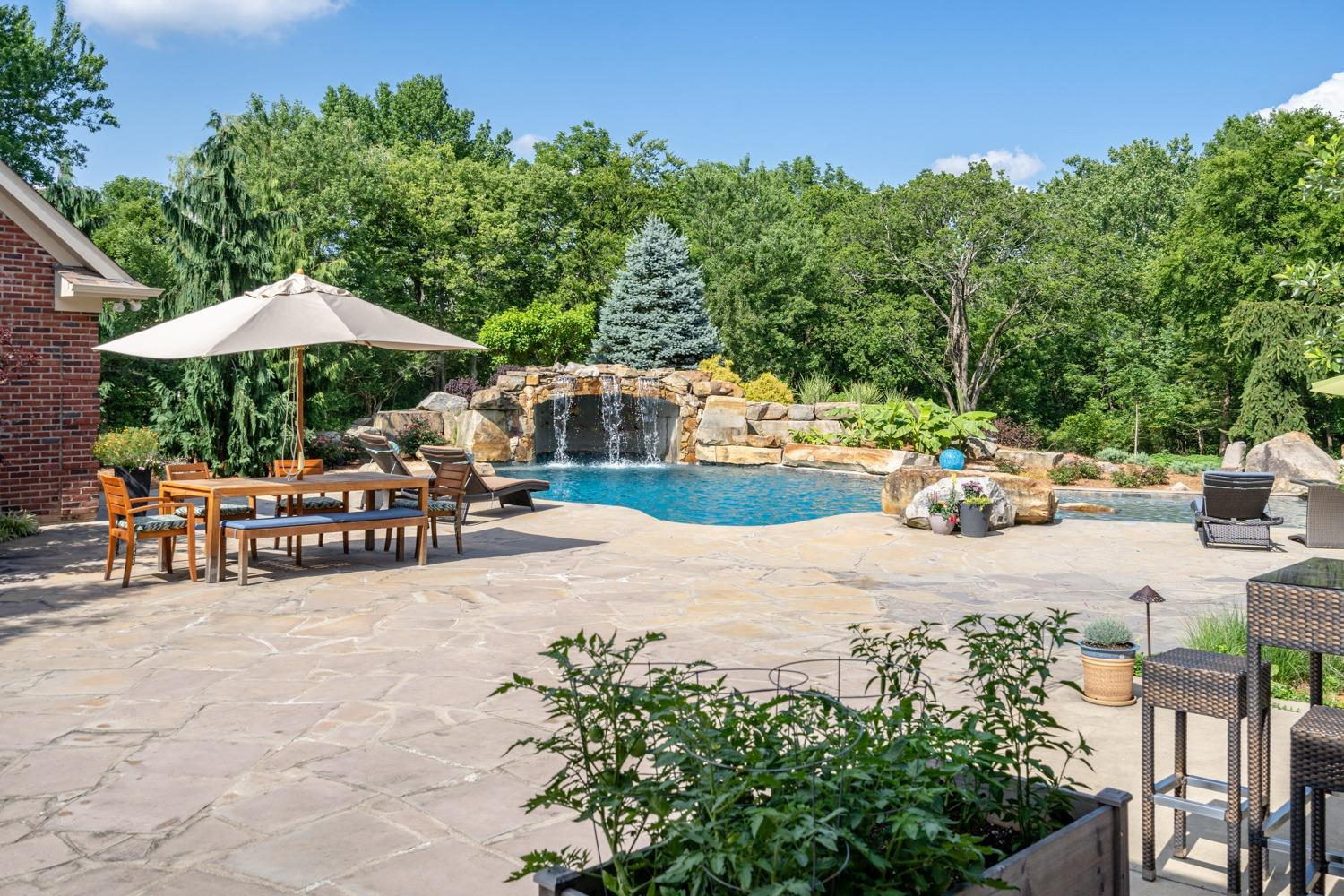 The very finest pool and setting! This 75,000 gallon gunite pool is complete with sun shelf, waterfall, and grotto. And the massive boulders are courtesy of the Buena Vista quarry… the same quarry that produced the rock used in the construction of the John A. Roebling bridge.