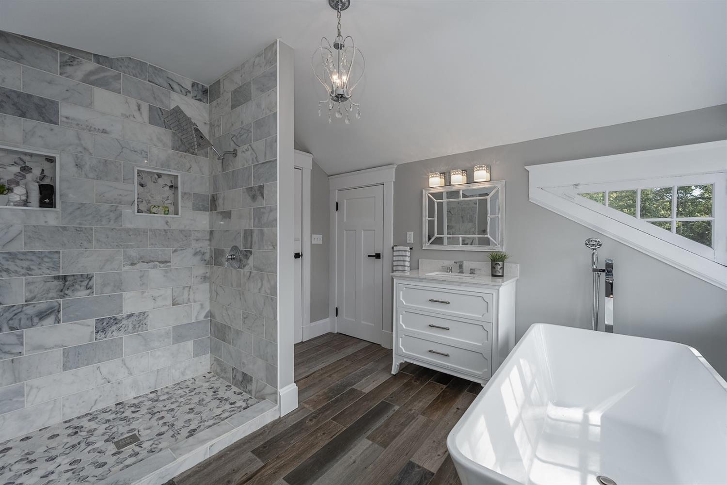 Marble Shower with custom shower pan and bluetooth speaker.