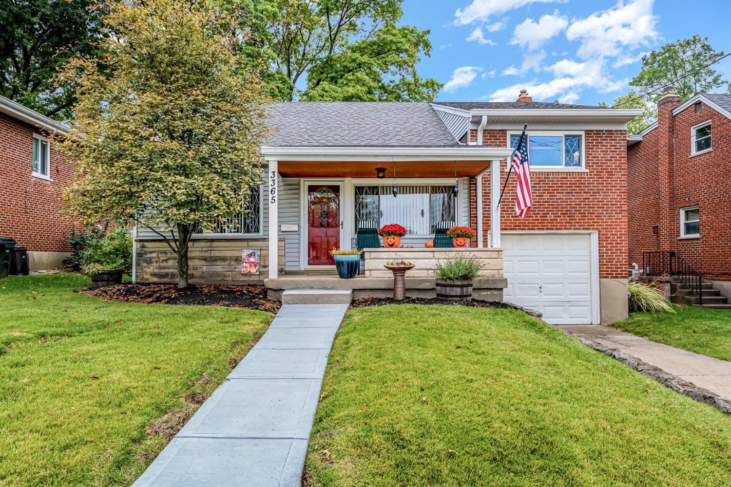 cute brick and vinyl QUAD, 4 bedrooms, main living room is open to dining & then a lower level family room! longtime owner has all the longterm updates ready for you