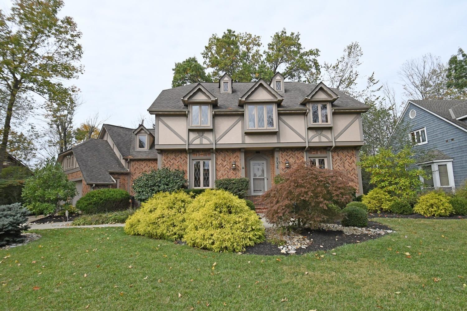 Former model, this stunning Tudor is located on a quiet cul-de-sac