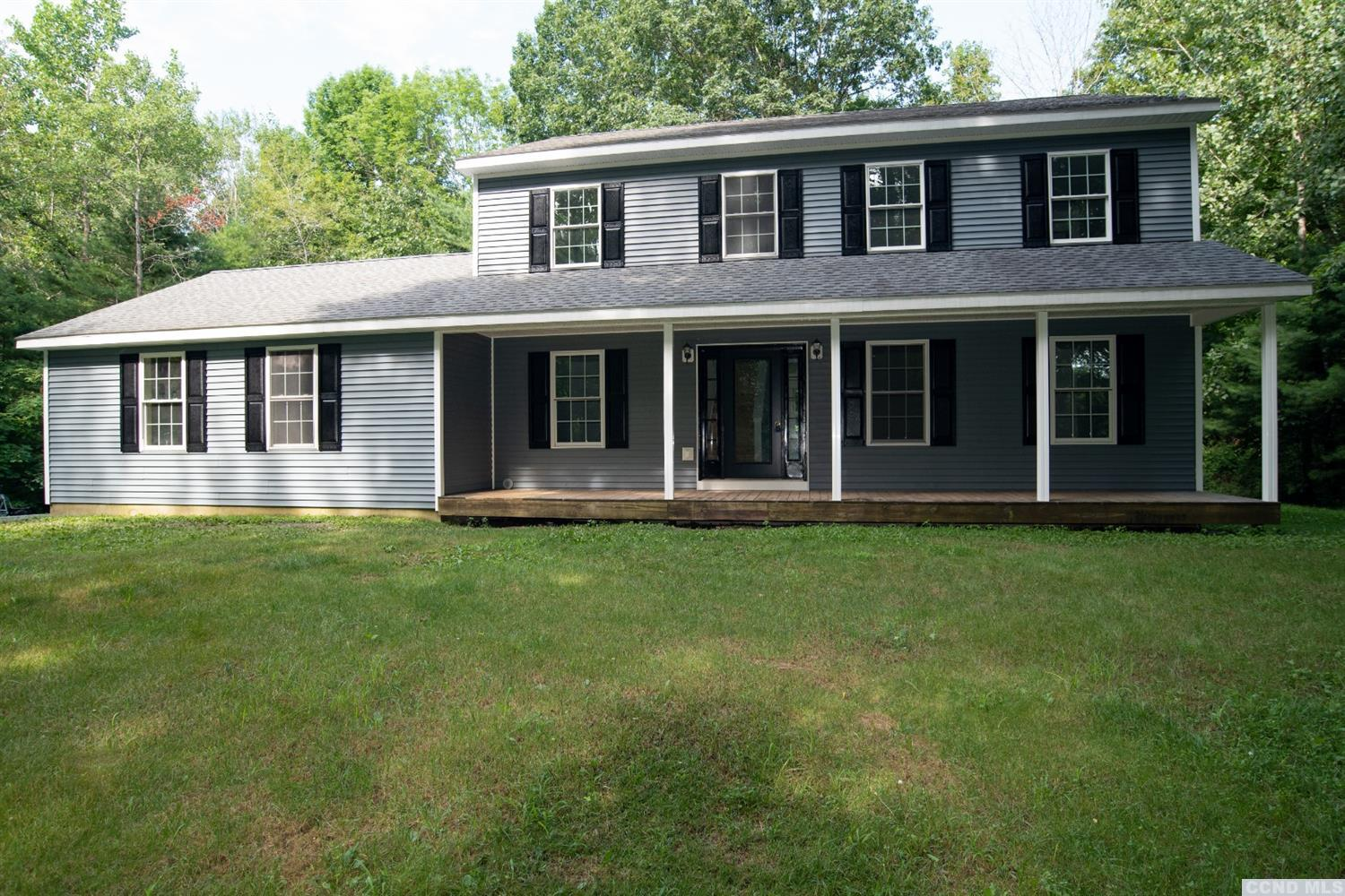 Secluded - yet close! Open the barn door from the mudroom/laundry and step into your gorgeous new 27 x 20 kitchen! If you love to cook, don't miss taking a look at this home.  Kitchen boasts granite counters and a 8'6 x 3' center isle with custom Maple top, dishwasher and double sink, all new stainless appliances...breakfast nook area too.  Kitchen opens to living room and formal dining room.  Upstairs is a large master bedroom with walk-in closet and full bath; 3 bedrooms and another full bath finish the area.  Wood laminate floors throughout. 2 car attached garage - 2 acres - new central air - 8 x 14 deck - Schodack Schools and just minutes to I-90...20 minutes to Hudson.  Fireplace could be added in living room.