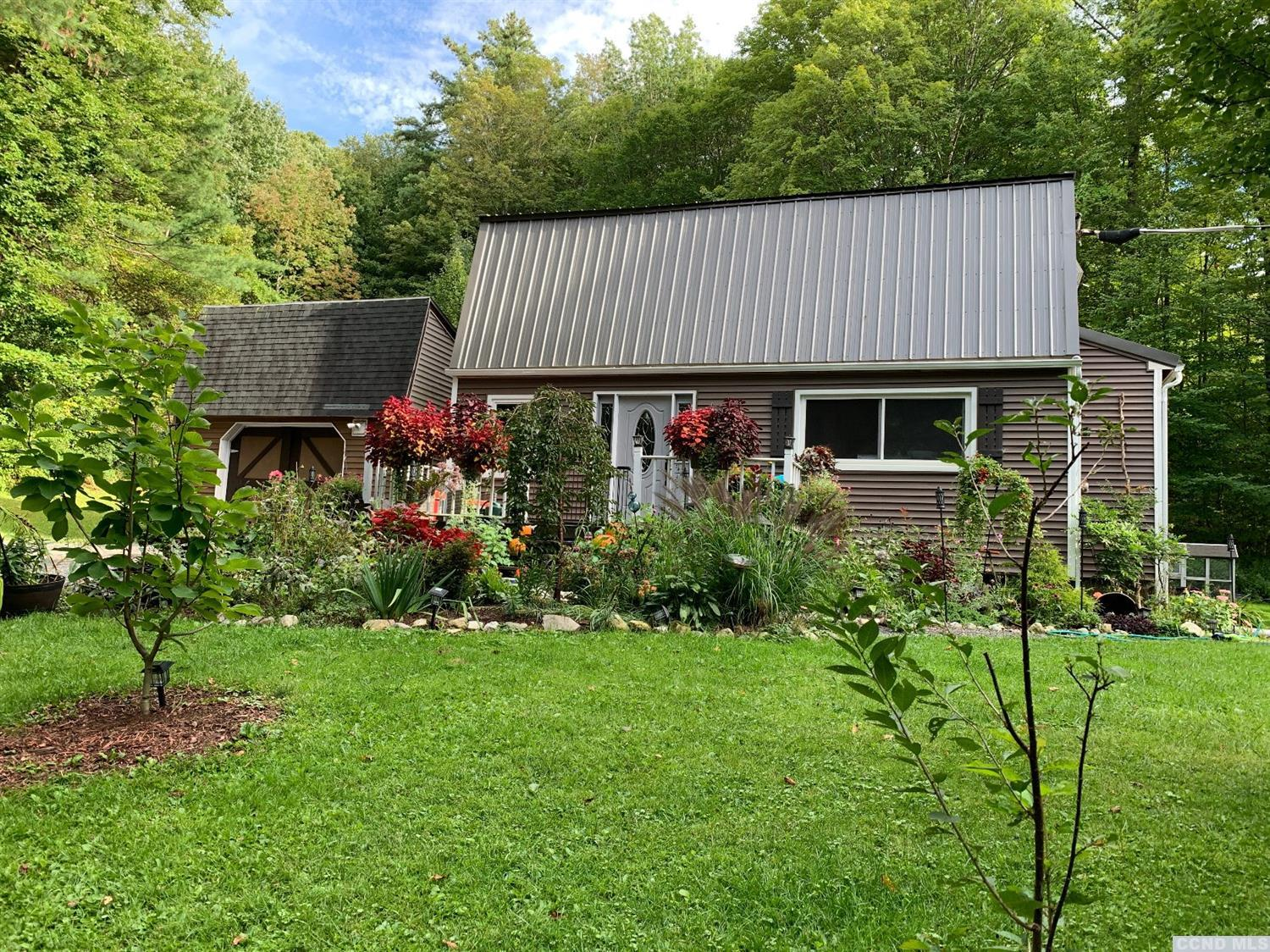 Private and secluded is this sweet, light filled Cottage style home on 5 acres.  Lots of renovations including new windows (warranty assumable), metal roof, new country kitchen, floors.  Open floor plan.  Two bedrooms and 1.5 baths with an office/ potential 3rd bedroom loft up a spiral staircase. Pellet stove to warm up the living area. Full unfinished basement with new water heater and poured floor. Beautifully landscaped with perennial gardens.  Front deck to soak up the pristine surroundings. Recent driveway upgrade. Close to the Berkshires, and Albany.<br>You've got to see this one.  Motivated sellers. OPEN HOUSE, Sunday, 12/15/2019, 11:00am - 1:00pm!