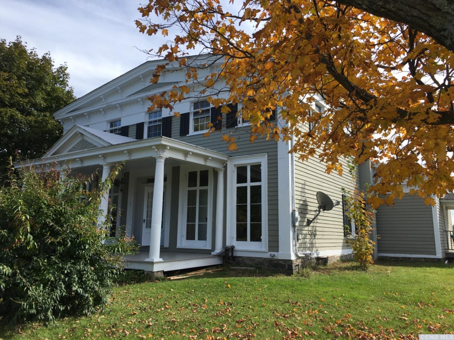 Exceptional 1840's Greek Revival on .90 acres with mt. Views. This historic home is full of character from the crown moldings, chair rails, 2 staircases and built in cabinets. Enjoy the newly renovated kitchen with stainless appliances. There are 4 bedrooms with original wide pine floors, and 2 updated bathrooms. Refinished hardwood floors on the 1st floor with 9' ceilings and spacious rooms. Relax on the back porch and enjoy the mt. view. There is a detached 2 car garage. Located in Greenville schools. Agent is Part owner.