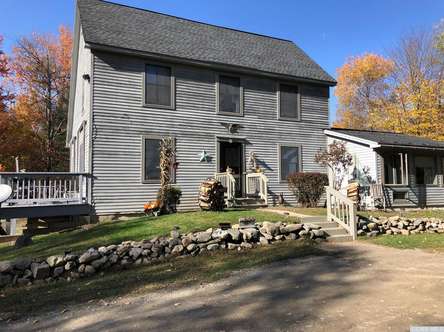 Private tucked away salt box home sitting on 4.97 acres with wooded acres, wrap around deck, cathedral ceiling in great room, 3  bedrooms (current sunroom makes 4th bedroom), 2 baths, wood floors thru-out, skylights brings in even more natural light into space, walkout basement currently has workshop set up, wood stove & fireplace for those chilly days upon us, so close to Jiminy Peak Resort for long weekend of skiing.  Sweet chickens roam the property w/ coop a nice country feel. <br>Plus in ground pool ready for next Summer!