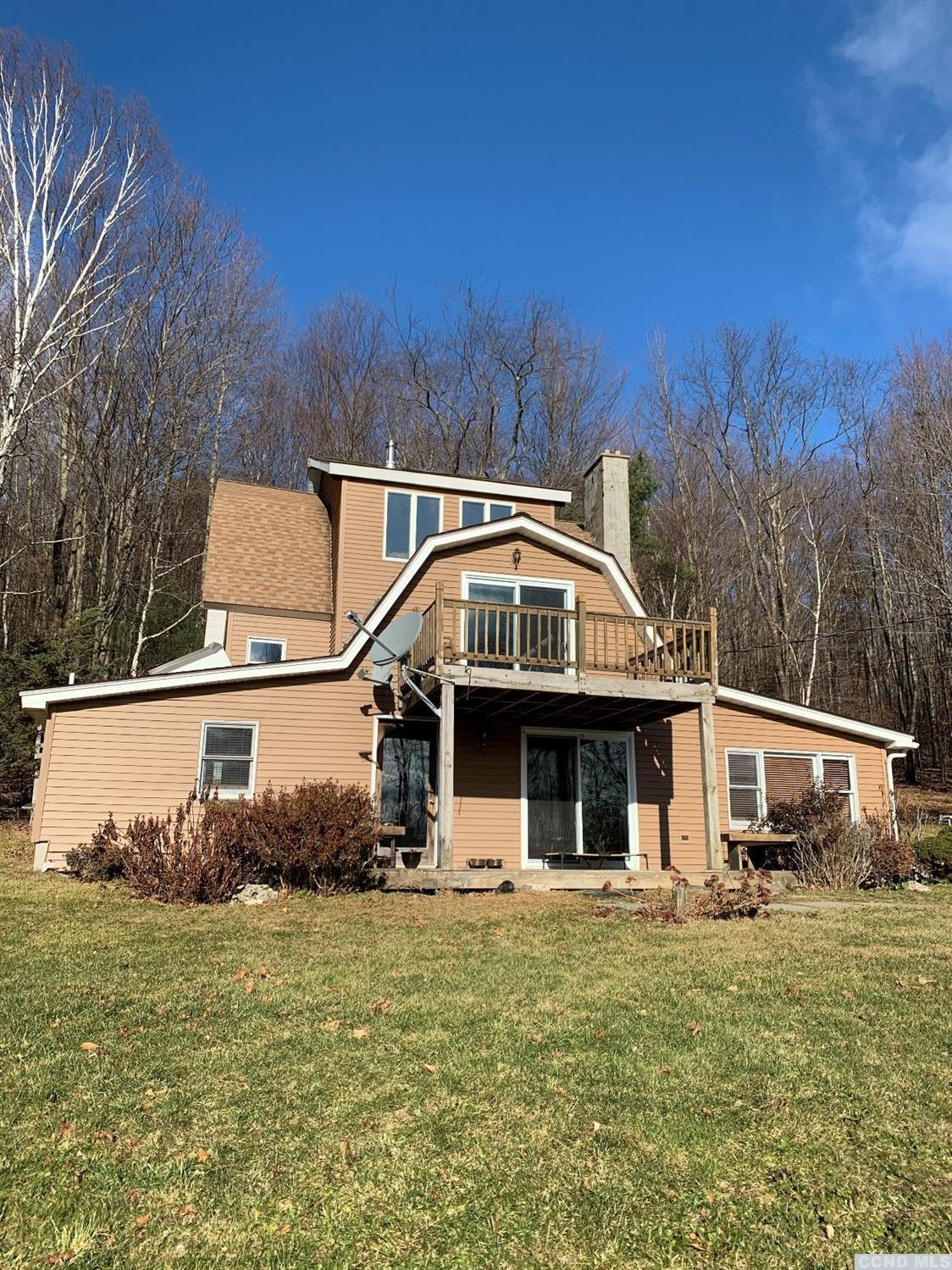 You'll feel right at home in this cozy 1960's contemporary set high on a hill.  Views of the Berkshires. Three floors of living space all with a view.  Pick your space in this one. Bedrooms with private decks. Cozy living/family room with wall of stone for a backdrop with a soapstone wood stove as the main focal point.  Sitting area on second floor.  Sweet retreat close to skiing or cultural events.  Privacy yet close to everything the Berkshires has to offer.  Within 30 minutes to Albany.